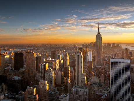Lia, would you rather live at the top of a tall NYC building or at the top of a mountain?