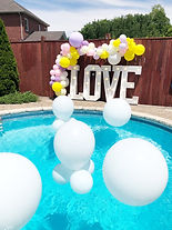 Pool Balloons and garland around Marquee letters