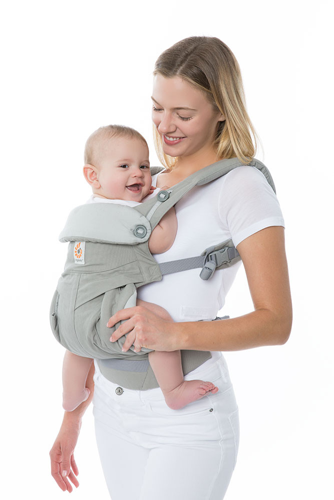 Lady carrying baby using Ergobaby Carrier