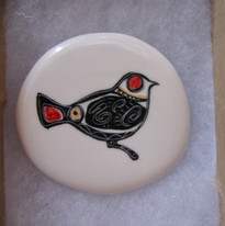 Sutton Hoo: Bird in black is inspired by the Finglesham gold and garnet bird brooch. (which is Anglo-Saxon but I do not believe was found at Sutton Hoo.)