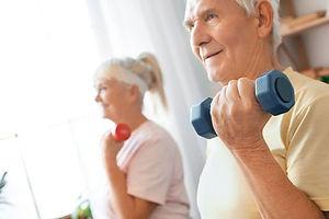 Seniorcoupleexercisetogetherathomehealth