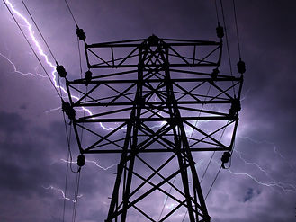 Electricity tower or pylon with a dramat