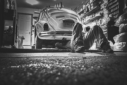Guy working on Classic VW Beetle