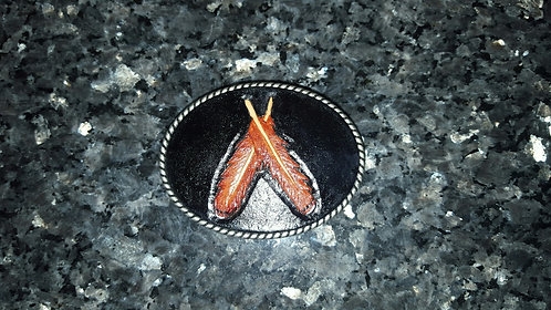Tooled red tail feather belt buckle
