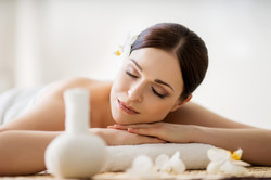 Young, beautiful and healthy woman in spa salon. Traditional oriental aroma therapy and beauty treat