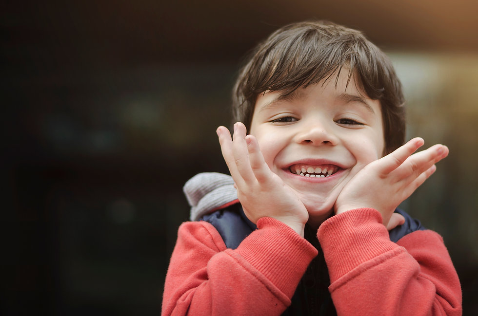 Canva - Smiling Boy in the Park.jpg