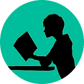 A silhouette of a person reading at a table, to symbolise independent learning.