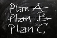 A blackboard with the words 'Plan A' and Plan B' crossed out and Plan C written underneath.