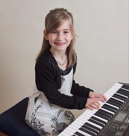 girl on piano.jpeg
