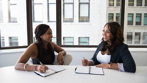 Two women in office, customized solar finance