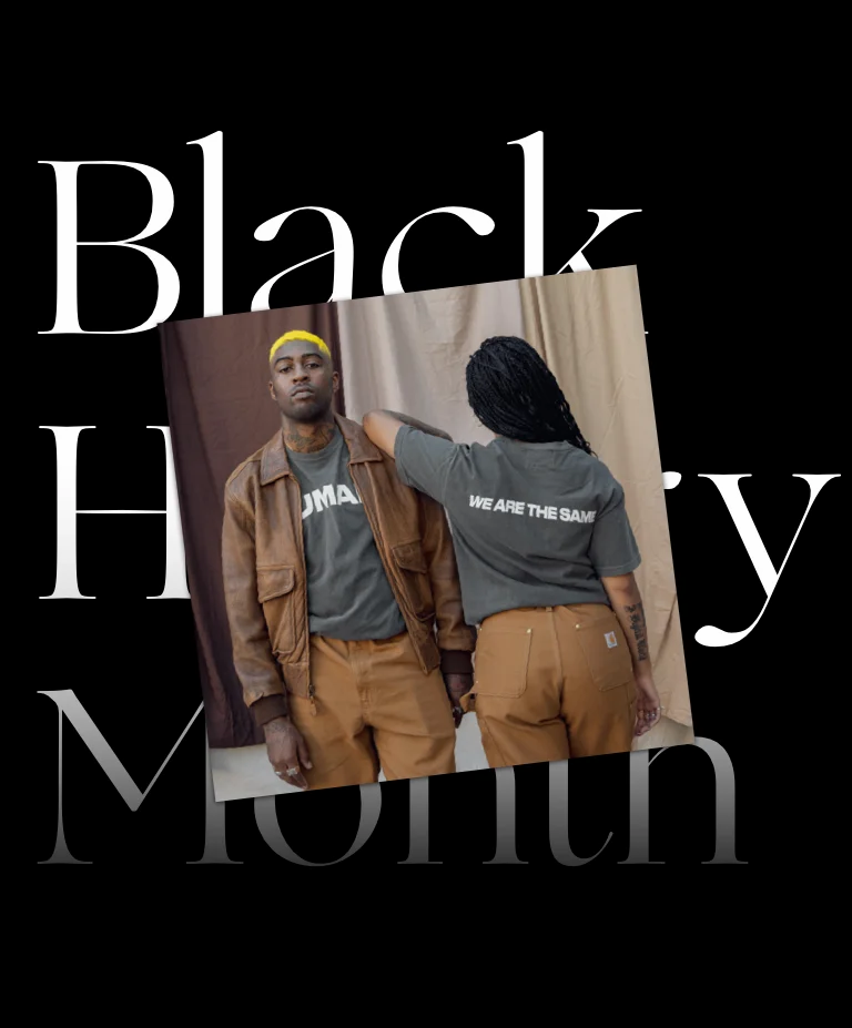 """A photo of two people wearing T-shirts that read """"Human"""" and """"We are the same,"""" against a Black History Month title."""