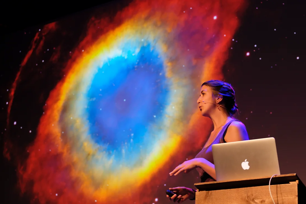 Nadieh Bremer speaking with a photo of outer space in the background