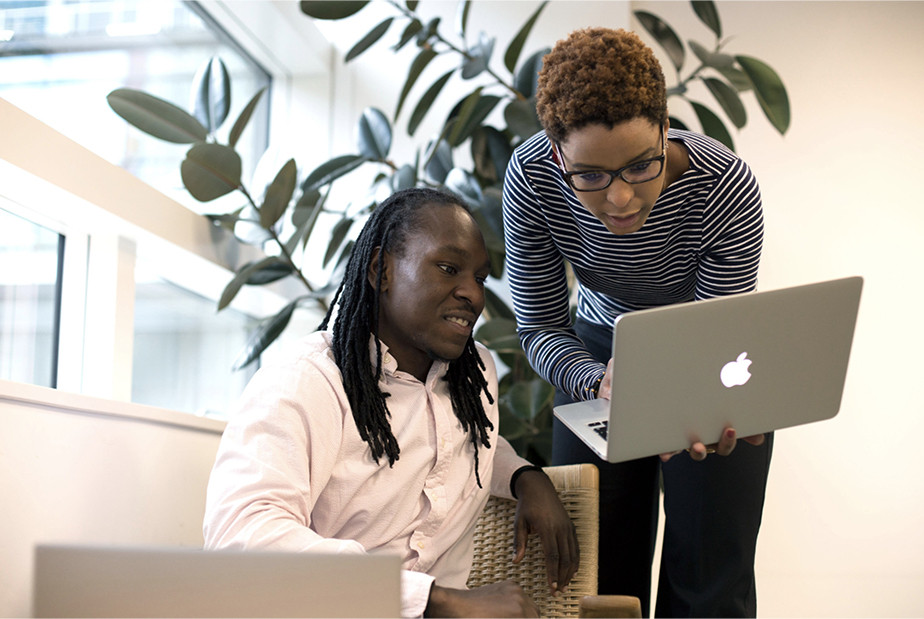 A stock photo of two people at work by UKBlackTech.