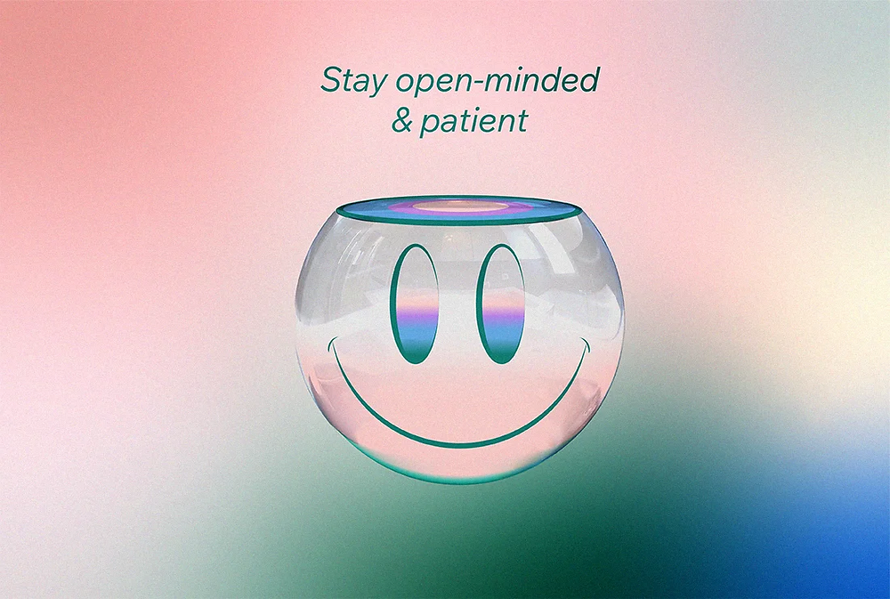 Stay open-minded & patient, with an illustration of a smiley face with an open head