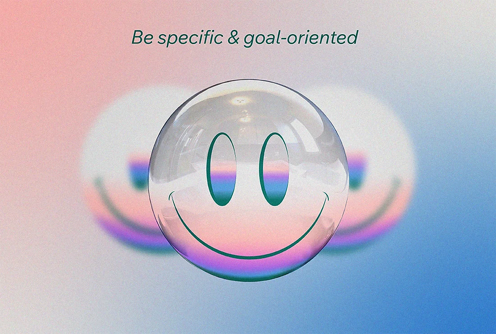 Be specific & goal-oriented, with an illustration of 3 smiley faces with only one being in focus