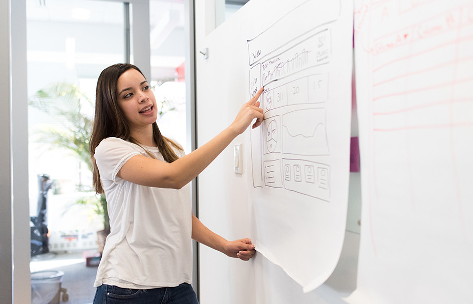 A stock photo by WOCinTech Chat of a woman at work.