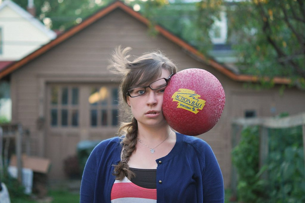 Girl hit in the face by a rubber ball