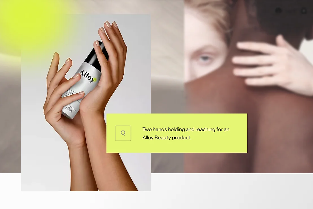 A photo of two hands holding and reaching for and Alloy Beauty product, and alt text describing it