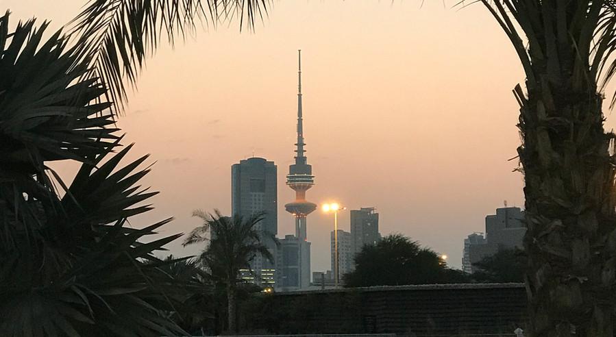 Sun setting behind Liberation Tower