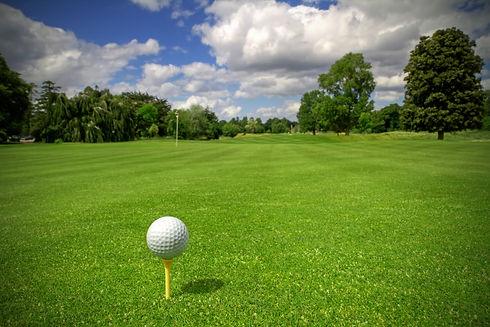 bigstock-Golf-ball-on-tee-in-a-beautifu-