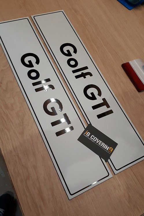 CACHES PLAQUES GOLF GTI ( LA PAIRE )