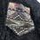 Thumbnail: Schwarze Vintagejacke mit beige/braunen Flicken
