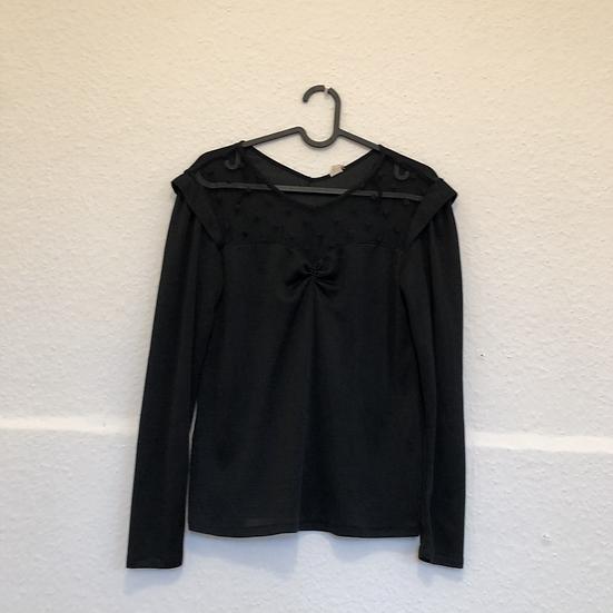 Schwarzer Top mit transparentem Vorderstück