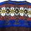 Thumbnail: Rostbrauner Norwegerpulli mit blau/rot/gelb