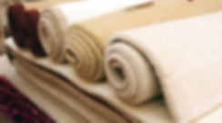 carpets stacked and rolled up for sale