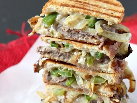 This Philly cheesesteak grilled cheese is packed with rare roast beef, onions and green peppers