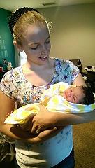 courtney scott birth doula holding newborn baby birth doula services san diego