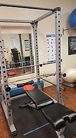 Body Solid squat rack, plus bench press.