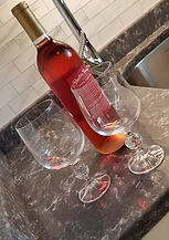 wine and wine glasses on countertop