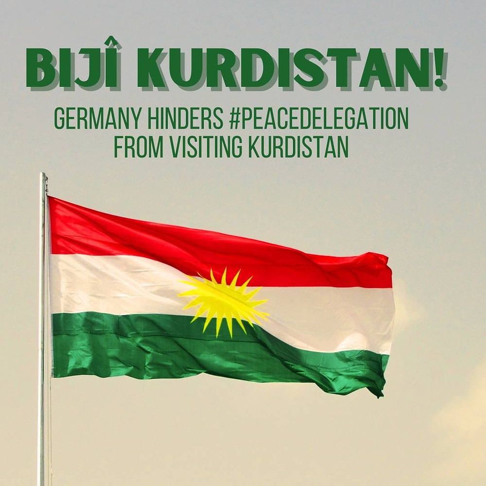Flag of Kurdistan with the text 'Germany hinders peace delegation from visiting Kurdistan'.