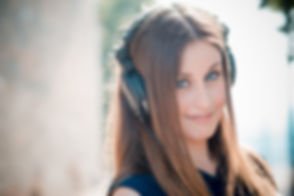 womane wearing headphones being hypnotis