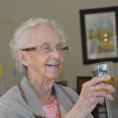 Resident cheering with a glass of wine