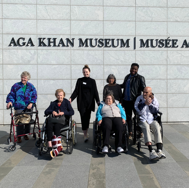 Greenview Museum Outing. Residents and staff posing for picture outside Aga Khan Museum.