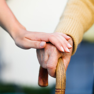 volunteer comforting a resident