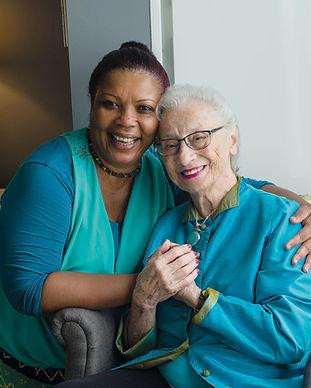 caregiver-hugs-resident-in-apartment