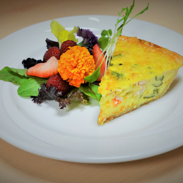 Picture of a plated dish: quiche with salad