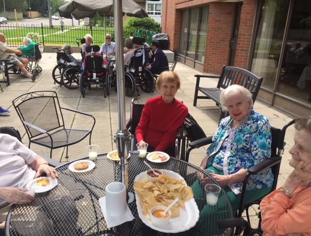 Residents having snacks on patio