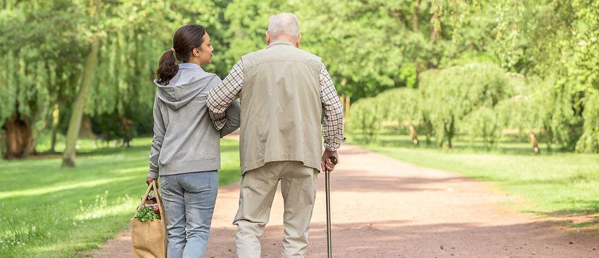 Senior Man walking with nurse