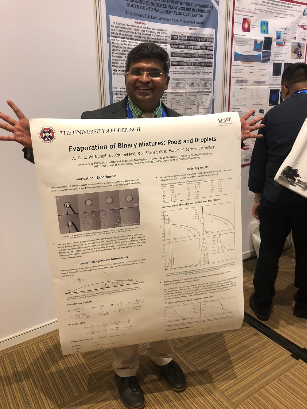 "Dr. Vallouri presenting his poster on ""Evaporation of Binary Mixtures: Pools and Droplets""."