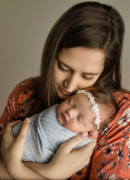 Sweet cuddles from this sweet momma at this baby girls newborn photography session