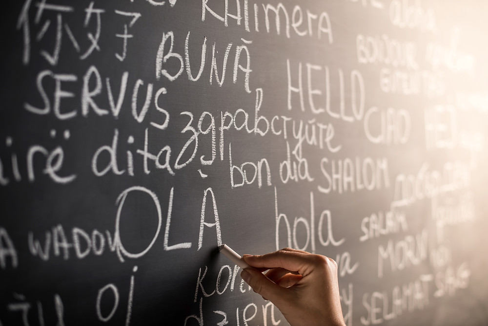 Chalkboard with various languages on it