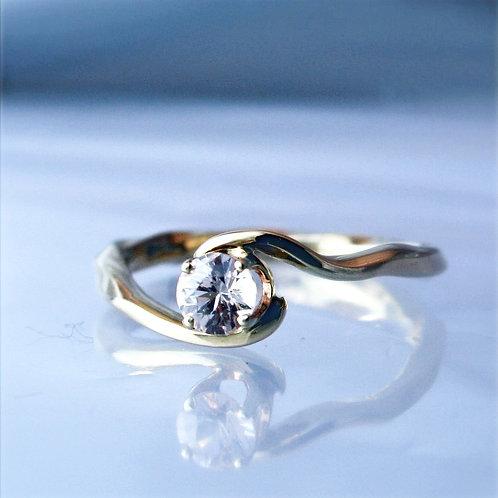 Handmade Twist and Turn 14karat gold ring with Sapphire