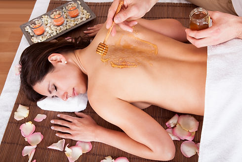 Beautiful young woman receiving spa trea