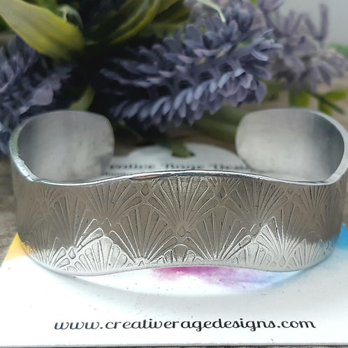 Wavy Cuff with Hand Rolled Fan Pattern