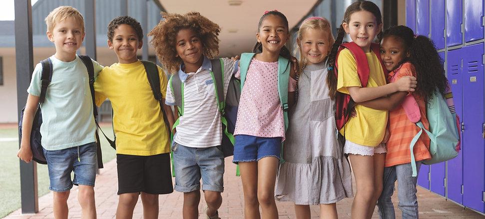 front-view-of-happy-school-kids-standing