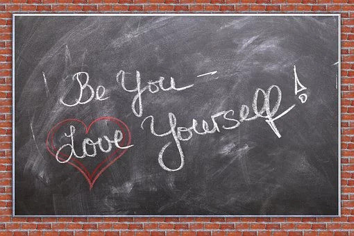 "Chalkboard with the words ""Be You -- Love Yourself"" with a heart around ""Love"""